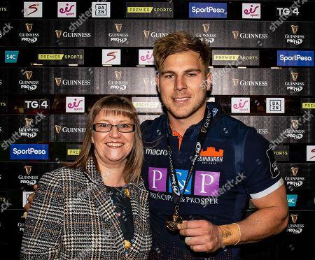 Scarlets vs Edinburgh. Edinburgh's Jaco van der Walt receives his man of the match award from Wendy Harding, on behalf of Guinness
