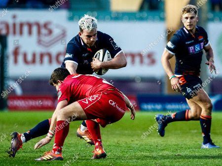 Scarlets vs Edinburgh. Edinburgh's Matt Scott is tackled by Dan Jones of Scarlets