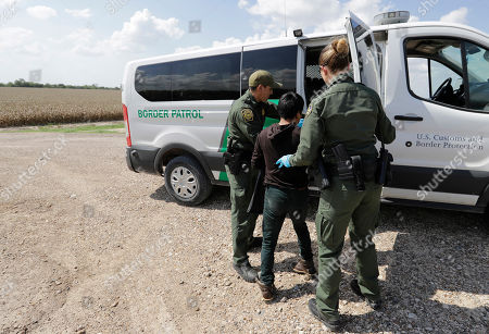 Immigrant. U.S. Border Patrol agents load a migrant from Guatemala into a van after he was caught trying to enter the United States illegally in Hidalgo, Texas. The Trump administration wants up to two years to find potentially thousands of children who were separated from their parents at the border before a judge halted the practice last year. The Justice Department said in a court filing late in San Diego that it will take at least a year to review the cases of 47,000 unaccompanied children taken in custody between July 1, 2017 and June 25, 2018