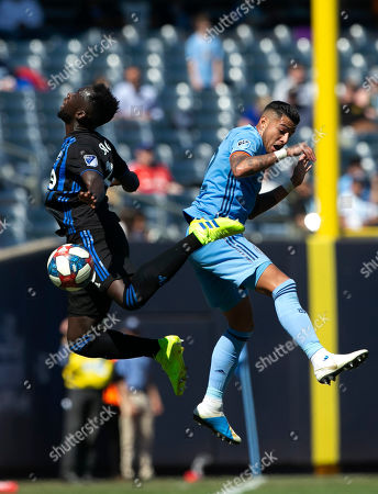 Montreal Impact defender Bacary Sagna (33) and New York City FC defender Ronald Matarrita (22) battle for a high ball during the second half of an MLS soccer match, in New York