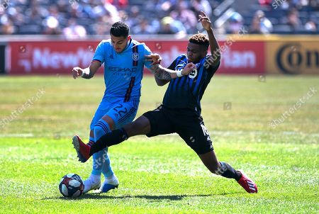New York City FC defender Ronald Matarrita (22) and Montreal Impact forward Orji Okwonkwo (18) battle for the ball during the second half of an MLS soccer match, in New York