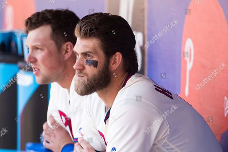 Philadelphia Phillies right fielder Bryce Harper (3) looks on from the dugout with first baseman Rhys Hoskins (17) during the MLB game between the Minnesota Twins and Philadelphia Phillies at Citizens Bank Park in Philadelphia, Pennsylvania