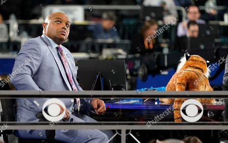 Charles Barkley sits on the pregame show stage before the semifinals of the Final Four NCAA college basketball tournament between Auburn ad Virginia, in Minneapolis
