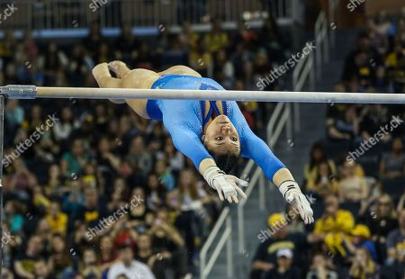 UCLA's Kyla Ross performs her bar routine (the routine would earn a perfect 10 score) during the Finals of the NCAA Gymnastics Ann Arbor Regional at Crisler Center in Ann Arbor, MI