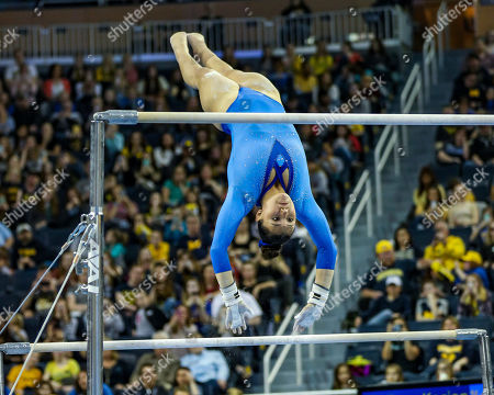 UCLA's Kyla Ross performs her bar routine during the Finals of the NCAA Gymnastics Ann Arbor Regional at Crisler Center in Ann Arbor, MI