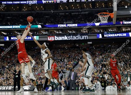 Texas Tech guard Matt Mooney, left, shoots over Michigan State guard Cassius Winston (5) during the first half in the semifinals of the Final Four NCAA college basketball tournament, in Minneapolis