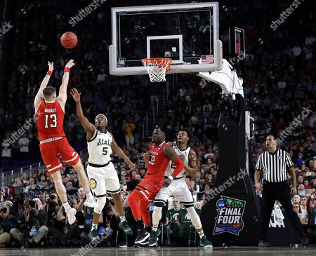 Stock Picture of Texas Tech guard Matt Mooney, left, shoots over Michigan State guard Cassius Winston (5) during the first half in the semifinals of the Final Four NCAA college basketball tournament, in Minneapolis