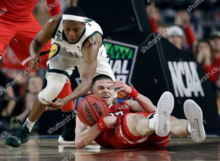 Stock Photo of Texas Tech's Matt Mooney (13) battles for a loose ball against Michigan State's Cassius Winston (5) during the second half in the semifinals of the Final Four NCAA college basketball tournament, in Minneapolis