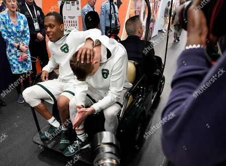 Stock Image of Michigan State's Cassius Winston, left, and Matt McQuaid react as they take a cart back to the locker room after the team's 61-51 loss to Texas Tech in the semifinals of the Final Four NCAA college basketball tournament, in Minneapolis