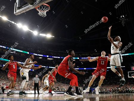 Michigan State guard Cassius Winston (5) shoots over Texas Tech guard Matt Mooney (13) during the first half in the semifinals of the Final Four NCAA college basketball tournament, in Minneapolis