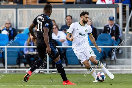 Portland Timbers midfielder Diego Valeri (8) crosses as San Jose Earthquakes defender Harold Cummings (31) defends in the second half of an MLS soccer match on in San Jose, Calif. The Earthquakes won 3-0