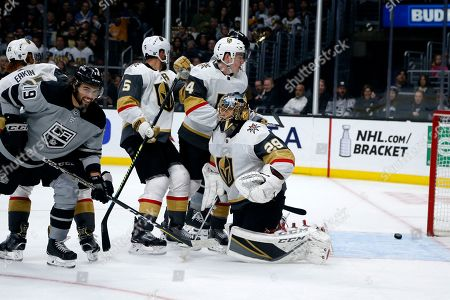 Los Angeles Kings forward Alex Iafallo (19) celebrates after a goal by forward Matt Roy during the second period against Vegas Golden Knights in an NHL hockey game, in Los Angeles