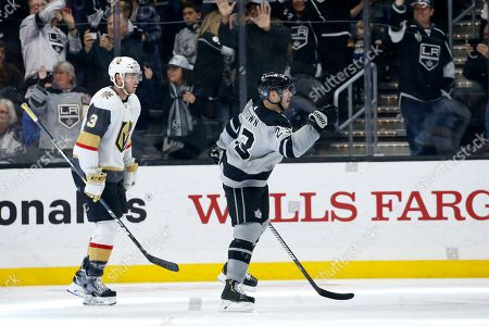Los Angeles Kings forward Dustin Brown (23) celebrates a goal by forward Anze Kopitar during the third period of an NHL hockey game against the Vegas Golden Knights, in Los Angeles. The Kings won 5-2