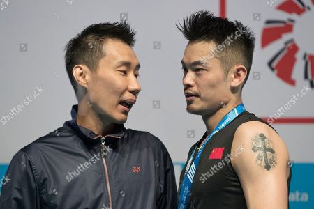 Lin Dan, Chen Long, Lee Chong Wei. China's Lin Dan, right, speaks with special guest Lee Chong Wei of Malaysia after the awards ceremony for the men's single final match at the Malaysia Badminton Open in Kuala Lumpur, Malaysia