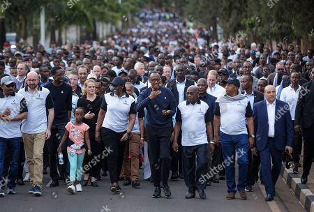 """Paul Kagame, Jeannette Kagame, Abiy Ahmed, Charles Michel, Herve Berville, Julie Payette. Rwanda's President Paul Kagame, center, gestures as he and first lady Jeannette Kagame, center-left, lead a """"Walk to Remember"""" accompanied by Ethiopia's Prime Minister Abiy Ahmed, far left, Prime Minister of Belgium Charles Michel, second left, France's Herve Berville, third left, and Governor General of Canada Julie Payette, fourth left, from the parliament building to Amahoro stadium in downtown Kigali, Rwanda . Rwanda is commemorating the 25th anniversary of when the country descended into an orgy of violence in which some 800,000 Tutsis and moderate Hutus were massacred by the majority Hutu population over a 100-day period in what was the worst genocide in recent history"""