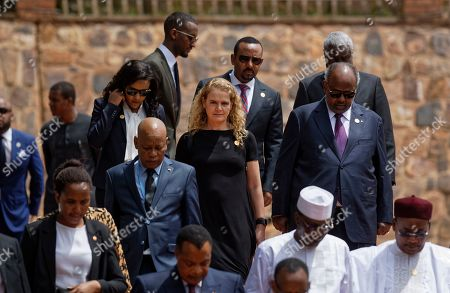 Governor General of Canada Julie Payette, center, arrives to lay a wreath at the Kigali Genocide Memorial in Kigali, Rwanda . Rwanda is commemorating the 25th anniversary of when the country descended into an orgy of violence in which some 800,000 Tutsis and moderate Hutus were massacred by the majority Hutu population over a 100-day period in what was the worst genocide in recent history