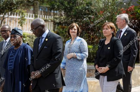 Marina Carobbio Guscetti, Cherie Blair, Cherie Booth, Olusegun Obasanjo. President of the Swiss National Council Marina Carobbio Guscetti, right, Britain's Cherie Blair, also known as Cherie Booth, center, and former President of Nigeria Olusegun Obasanjo, left, arrive to lay wreaths at the Kigali Genocide Memorial in Kigali, Rwanda . Rwanda is commemorating the 25th anniversary of when the country descended into an orgy of violence in which some 800,000 Tutsis and moderate Hutus were massacred by the majority Hutu population over a 100-day period in what was the worst genocide in recent history