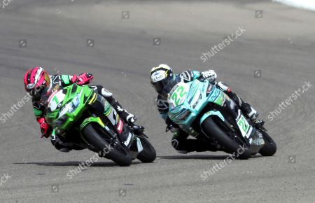 Supersport300 Spanish rider Ana Carrasco (L) in action ahead of Dutch Koen Meuffels (R) during the 2019 Supersport300 World Championship, held at the Motorland Alcaniz circuit in Alcaniz, Teruel, northern Spain, 07 April 2019.