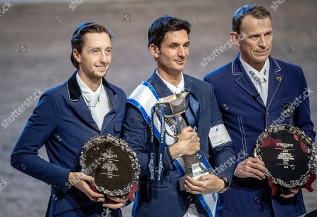 (L-R) Martin Fuchs of Switzerland, second place, Steve Guerdat of Switzerland vinner and Swedens Peder Fredricson, third place celebrate on the podium for the FEI World Cup final 3 show jumping event at Gothenburg Horse Show in the Scandinavium Arena in Gothenburg, Sweden, 07 April 2019.
