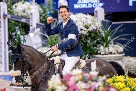 Stock Image of The winner Steve Guerdat of Switzerland rides Alamo during  FEI World Cup final 3 show jumping event at Gothenburg Horse Show in the Scandinavium Arena in Gothenburg, Sweden, 07 April 2019.