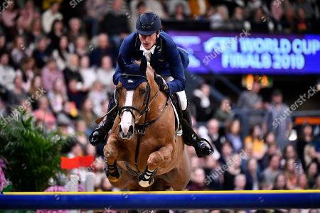 Germany's Daniel Deusser rides Scuderia 1918 Tobago Z during the FEI World Cup final 3 show jumping event at Gothenburg Horse Show in the Scandinavium Arena in Gothenburg, Sweden, 07 April 2019.