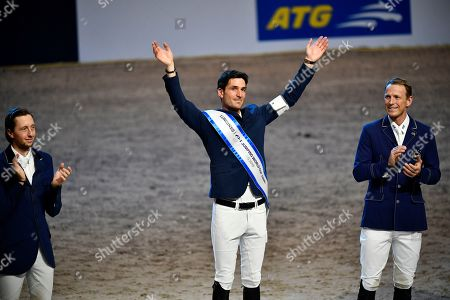 Stock Photo of (L-R) Martin Fuchs of Switzerland, second place, Steve Guerdat of Switzerland vinner and Swedens Peder Fredricson, third place celebrate on the podium for the FEI World Cup final 3 show jumping event at Gothenburg Horse Show in the Scandinavium Arena in Gothenburg, Sweden, 07 April 2019.
