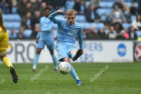 Stock Image of Coventry City midfielder (on loan from Derby County Luke Thomas (23) takes a shot at goal during the EFL Sky Bet League 1 match between Coventry City and Bristol Rovers at the Ricoh Arena, Coventry