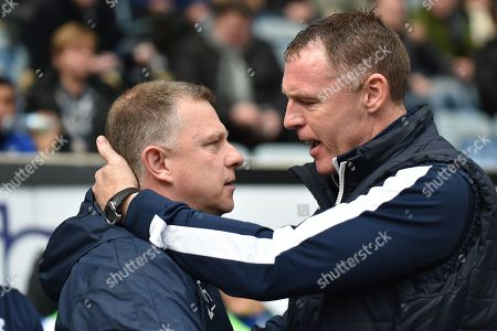 Coventry City manager Mark Robins  greets Bristol Rovers manager Graham Coughlan during the EFL Sky Bet League 1 match between Coventry City and Bristol Rovers at the Ricoh Arena, Coventry