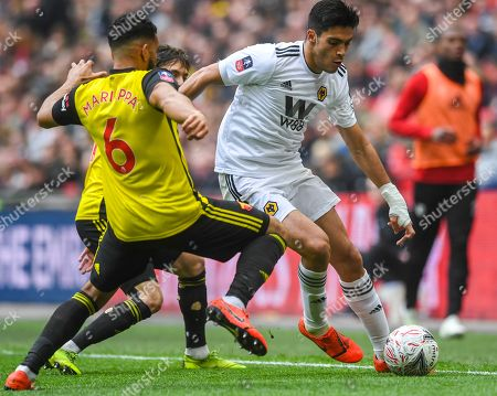 Wolverhampton Wanderers' Raul Jimenez (R) in action against Watford's Adrian Mariappa (L) during the English Emirates FA Cup semi final match between Watford and the Wolverhampton Wanderers at the Wembley stadium, London, Britain, 07 April 2019.