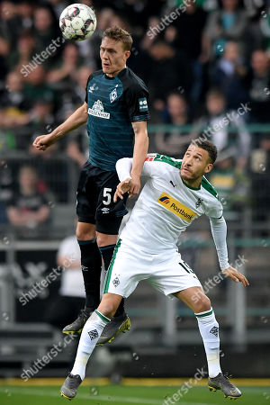 Bremen's Ludwig Augustinsson (L) in action against Moenchengladbach's Fabian Johnson (R) during the German Bundesliga soccer match between Borussia Moenchengladbach and Werder Bremen at Borussia-Park in Moenchengladbach, Germany, 07 April 2019.