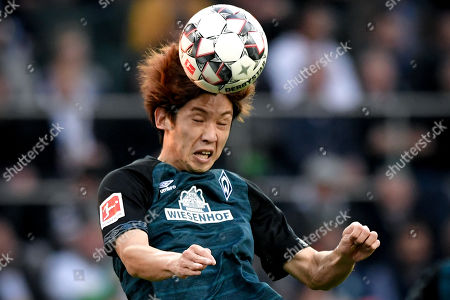 Bremen's Yuya Osako in action during the German Bundesliga soccer match between Borussia Moenchengladbach and Werder Bremen at Borussia-Park in Moenchengladbach, Germany, 07 April 2019.