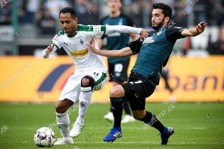 Moenchengladbach's Raffael (L) in action against Bremen's Nuri Sahin (R) during the German Bundesliga soccer match between Borussia Moenchengladbach and Werder Bremen at Borussia-Park in Moenchengladbach, Germany, 07 April 2019.