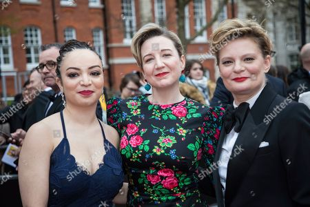 Lynette Linton, Josie Rourke, Martha Plimpton. Lynette Linton, Josie Rourke and Martha Plimpton pose for photographers upon arrival at the Olivier Awards in London