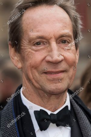Jonathan Hyde poses for photographers upon arrival at the Olivier Awards in London