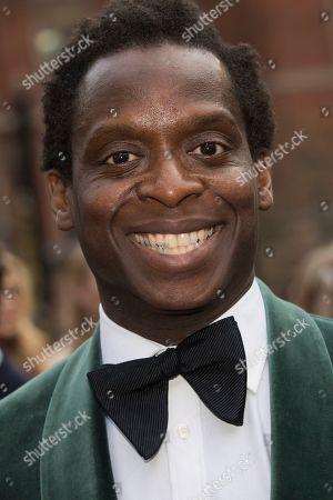 Kobna Holdbrook-Smith poses for photographers upon arrival at the Olivier Awards in London