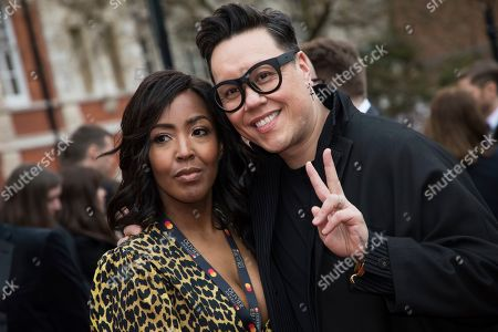 Angellica Bell, Gok Wan. Angellica Bell and Gok Wan pose for photographers upon arrival at the Olivier Awards in London