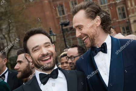 Charlie Cox, Tom Hiddleston. Charlie Cox and Tom Hiddleston pose for photographers upon arrival at the Olivier Awards in London
