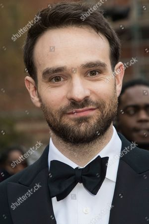 Charlie Cox poses for photographers upon arrival at the Olivier Awards in London