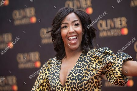 Angellica Bell poses for photographers upon arrival at the Olivier Awards in London