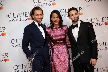 Tom Hiddleston, Zawe Ashton, Charlie Cox. Tom Hiddleston, Zawe Ashton and Charlie Cox pose for photographers backstage at the Olivier Awards in London