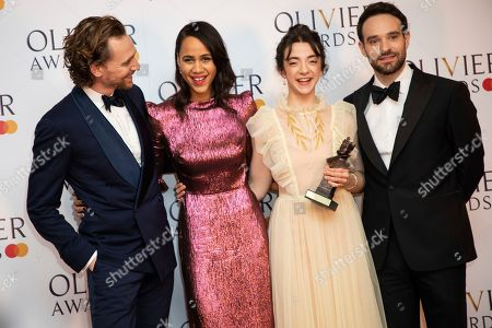 Tom Hiddleston, Zawe Ashton, Patsy Ferran, Charlie Cox. Actor Tom Hiddleston, from left, actors Zawe Ashton, Patsy Ferran and Charlie Cox pose for photographers backstage at the Olivier Awards in London
