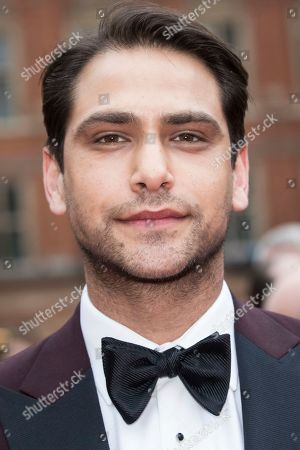 Stock Image of Luke Pasqualino poses for photographers upon arrival at the Olivier Awards in London