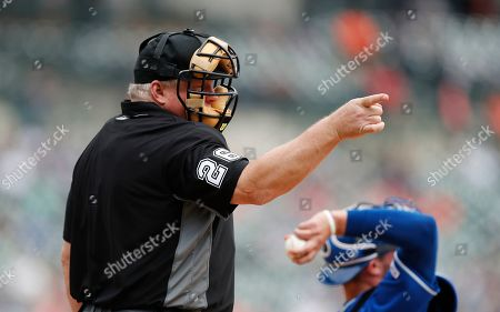 Umpire Bill Miller signals during the ninth inning of a baseball game between the Detroit Tigers and the Kansas City Royals, in Detroit