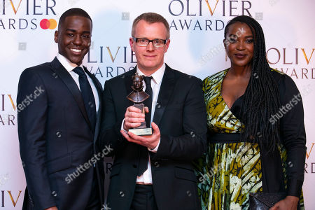 Igor accepts the award for Best Set Design for Company on behalf of Bunny Christie, presented by Ncuti Gatwa and Wunmi Mosaku