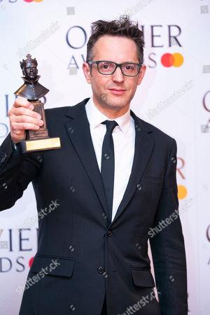 Jon Clark accepts the award for Best Lighting Design for The Inheritance