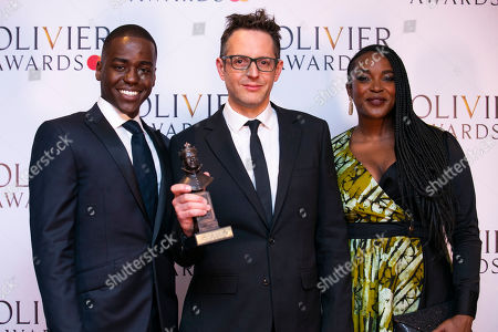 Jon Clark accepts the award for Best Lighting Design for The Inheritance, presented by Ncuti Gatwa and Wunmi Mosaku