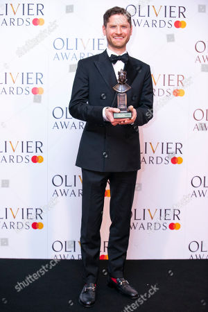 Kyle Soller accepts the award for Best Actor for The Inheritance