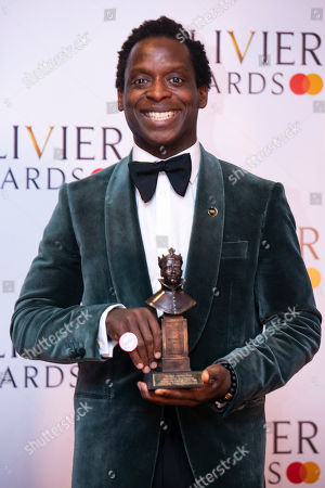 Kobna Holdbrook-Smith accepts the award for Best Actor in a Musical for Tina: The Tina Turner Musical