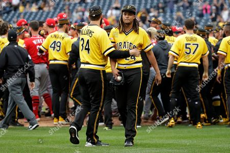 Pittsburgh Pirates starting pitcher Chris Archer (24) walks away from a bench clearing brawl with fellow pitcher Trevor Williams (34) during the fourth inning of a baseball game in Pittsburgh, . A wild pitch by Archer during an at-bat by Reds' Derek Dietrich started the fight
