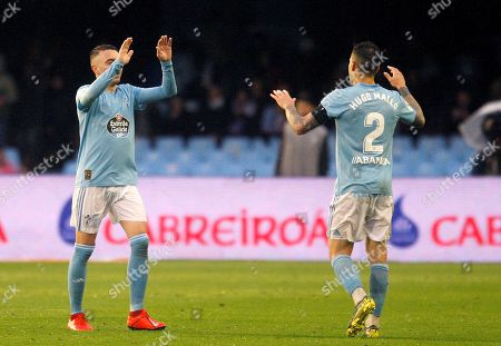 Celta Vigo's Iago Aspas (L) and Hugo Mayo (R) celebrate a goal during their Spanish LaLiga soccer match against Real Sociedad played at the Balaidos stadium in Vigo, northwestern Spain, 07 April 2019.